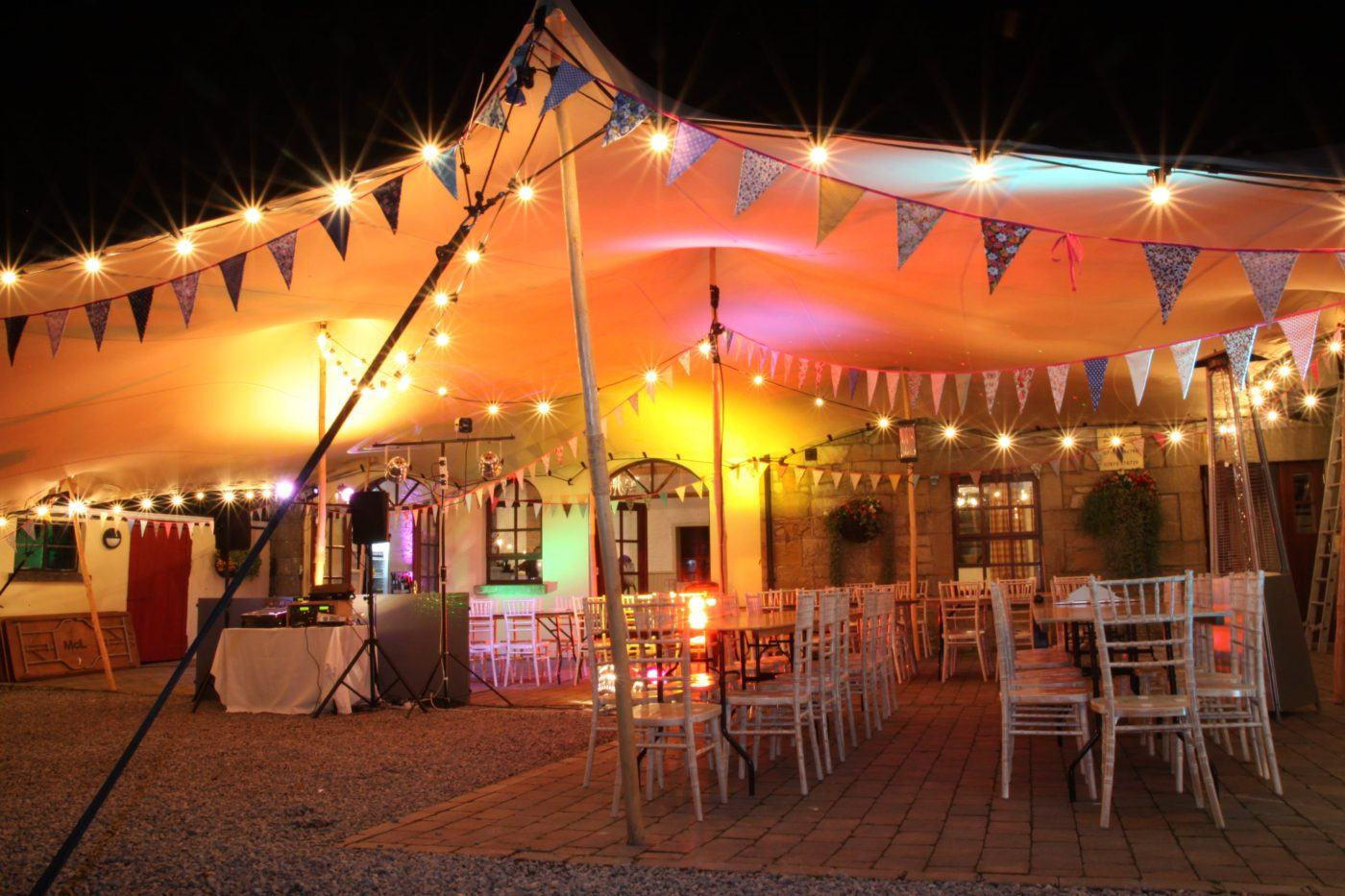 The Coach house with an extended Marquee decorated for a wedding at blessingbourne estate