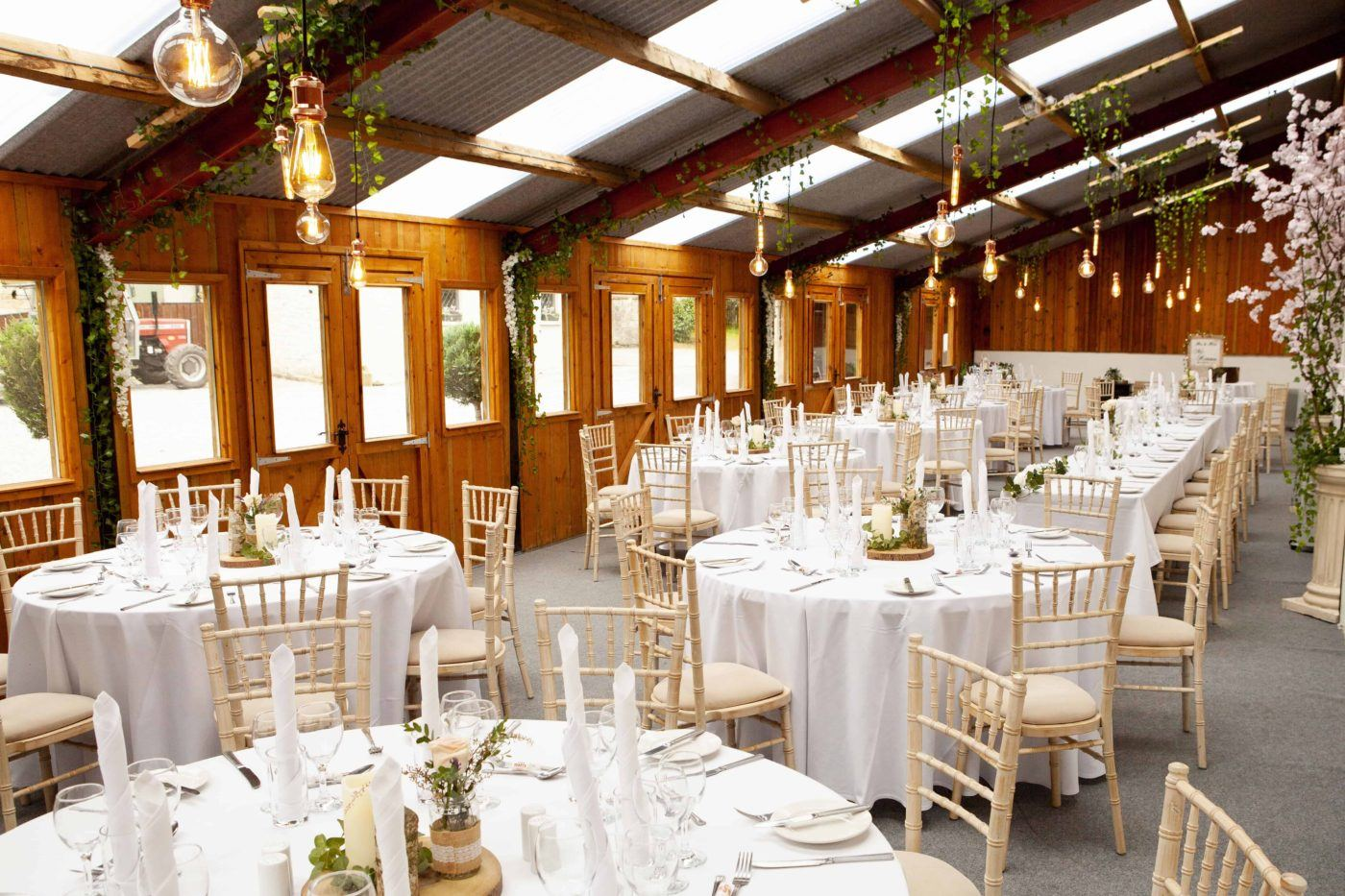 Long Barn decorated for a wedding reception at Blessingbourne estate